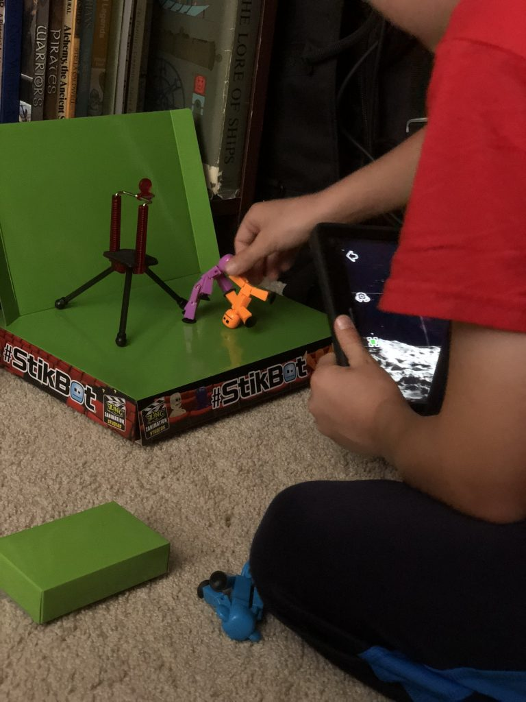 Kid playing with stikbots